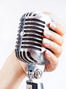 Retro microphone in woman's hand Stock Photography