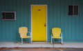 Retro motel room motels in america offered two metal chairs at the door for relaxing Royalty Free Stock Photography