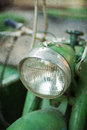 Retro motorbike green vintage headlamp textured image Stock Image