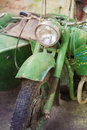 Retro motorbike green vintage headlamp textured image Stock Photos