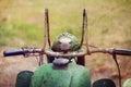 Retro motorbike green vintage headlamp textured and toned image Royalty Free Stock Photo