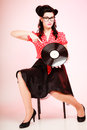 Retro music. Pinup girl with vinyl record Royalty Free Stock Photo