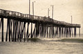 Retro ocean pier large fishing with rough surf vintage image with noise added Royalty Free Stock Photo