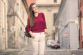 Retro old city street out of focus young girl posing outdoors su
