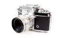 Retro old vintage analog photo camera on white background view from the side Royalty Free Stock Photography