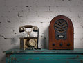 Retro old wooden radio and old telephone set Royalty Free Stock Photo