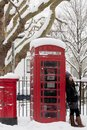 Retro phone booth in the snow Royalty Free Stock Photo
