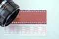 Retro photo camera with film strip Royalty Free Stock Photo