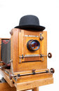 Retro photo camera wooden and bowler hat Stock Photo