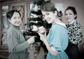 Retro photo of girls with mother at Christmas tree Stock Images