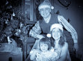 Retro photo of happy family near christmas tree three at home Royalty Free Stock Photography