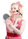 Retro pin up woman doing beauty make up style portrait of beautiful blond girl on white background Stock Photos