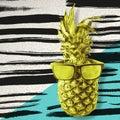 Retro pineapple in sunglasses over paint brush art
