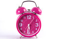 Retro pink alarm clock isolated on white Royalty Free Stock Photo