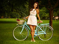 Retro pinup girl with bike portrait of pretty blue bycicle in style Stock Images