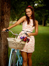 Retro pinup girl with bike portrait of pretty blue bycicle in style Stock Photography