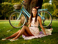 Retro pinup girl with bike portrait of pretty blue bycicle in style Royalty Free Stock Images