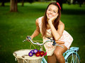 Retro pinup girl with bike portrait of pretty blue bycicle in style Stock Image