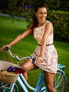 Retro pinup girl with bike portrait of pretty blue bycicle in style Stock Photo