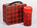 Retro plaid lunch box an old and matching thermos bottle Stock Images