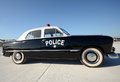 Retro police car old american parked side view Royalty Free Stock Photography