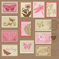 Retro postage stamps with butterflies and flowers for wedding design invitation scrapbook Royalty Free Stock Photo