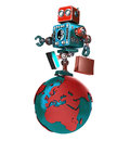 Retro Robot with shopping bag walking around the globe. . Contains clipping path Royalty Free Stock Photo