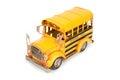 Retro school bus tin toy model on white background Stock Photography