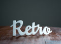Retro sign on wooden table great for use in your design Stock Photo