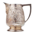 Retro silver creamer vintage milk jug isolated on white Royalty Free Stock Image