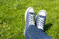 Retro Sneakers On Green Grass Royalty Free Stock Photo