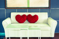 Retro sofa and heart pillows with green window in color style Royalty Free Stock Images