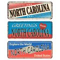 Vintage Tin Sign With America State North Carolina Retro Souvenir Or Postcard Template On Rust Background.