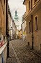 Retro street in Bratislava at sunset. Royalty Free Stock Photo