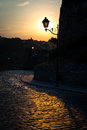 Retro street lamp in the city park at summer sunset. Royalty Free Stock Photo