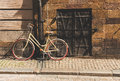 A retro style bicycle changed to a pole, in the old townGamla Stan of Stockholm, Sweden.