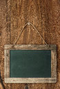 Retro style chalkboard on wooden wall rustic background with empty field for your text Stock Photo