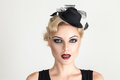 Retro style fashion woman with smoky make up and vintage hat Stock Images