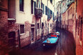 Retro style image of small canal in Venice Royalty Free Stock Photos