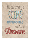 Retro style motivational poster with calligraphy text encouraging people to remember that even that which seems impossible is Royalty Free Stock Photos