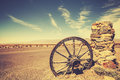 Retro style old cartwheel, wild west concept, USA. Royalty Free Stock Photo