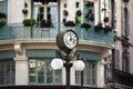 Retro style street clock with lantern Royalty Free Stock Photo