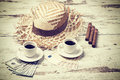 Retro style summer adventure concept filtered coffees cigars money and hats Royalty Free Stock Photo