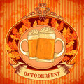 Retro styled emblem with glasses of beer, autumn leaves and the text Beer festival Oktoberfest on wooden background.