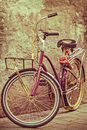 Retro styled image of a colorful bicycle bike against an old wall Stock Image