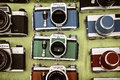 Retro styled image of colorful photo cameras on a flee market Royalty Free Stock Photo