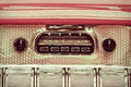 Retro styled image of an old car radio Royalty Free Stock Photo
