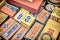 Retro styled image of old color slide film packs on a flee marke Royalty Free Stock Photo