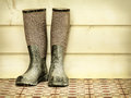 Retro styled image of an old pair of boots Royalty Free Stock Photo