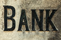 Retro styled image of an old stone bank sign carved in a wall Stock Photos